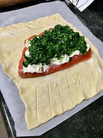 Salmon with cheese and spinach en croute