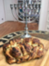 Chanukah challah with chanukiah.jpg