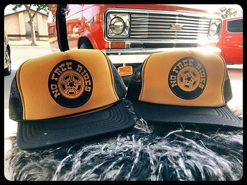 No Free Rides Wheel on mustard hats