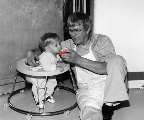 Grandpa Kerney feeding little Craig an apple at the bakery2