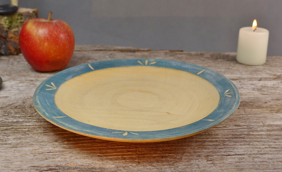 Wooden plate with milk paint and carved detail
