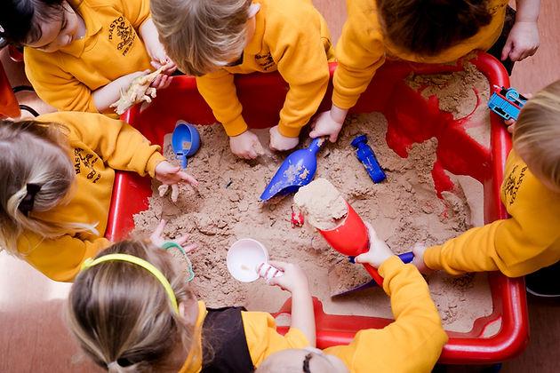 Baston Pre-School children playing in sandpit
