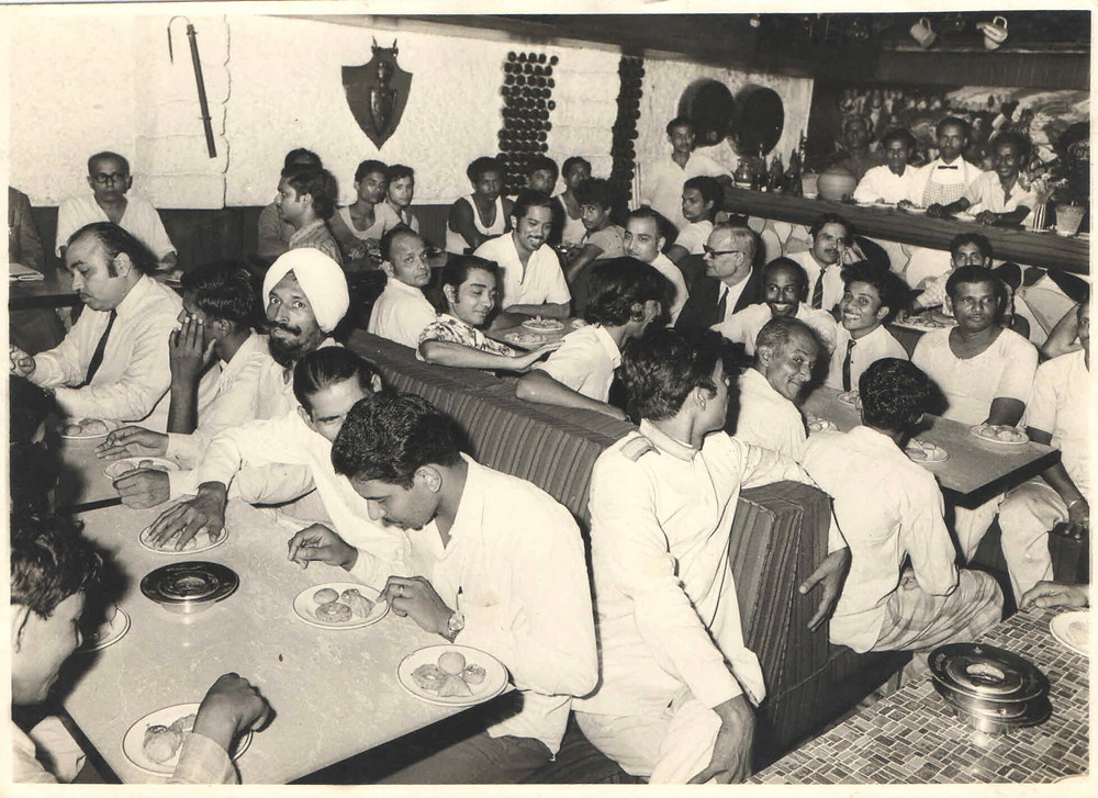 A staff meeting in progress in the 70s at The Tavern in Trincas