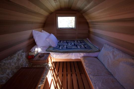 Barrel cabin inside facing back window