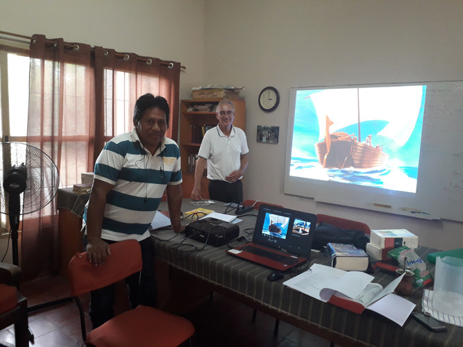 Tim and Asunción working on captions in the Énxet language at the translation office in Rio Verde early 2020