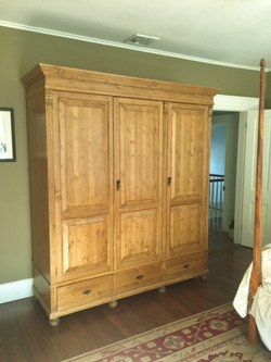 Three door pine armoire
