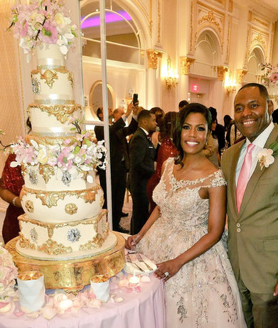 Omarosa Manigault Ivory and Gold Baroque Cherry Blossom Wedding Cake