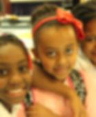 Three children, all smiling.JPG
