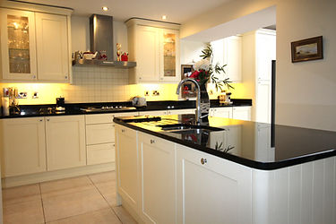 Shaker style kitchen with an island and granite worktops
