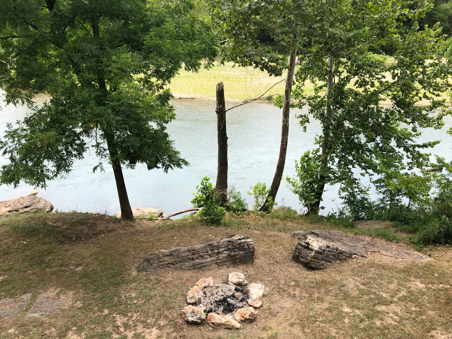 Private setting area with rock fire pit.