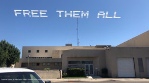 """""""Free Them All""""   Estamos Unidos  Yuba County, CA  Go to: Yuba County Jail, 215 5th St, Marysville, CA 95901  Part of, In Plain Sight, conceived by Cassils and rafa esparza, a coalition of 80 artists fighting immigrant detention and the culture of incarceration"""