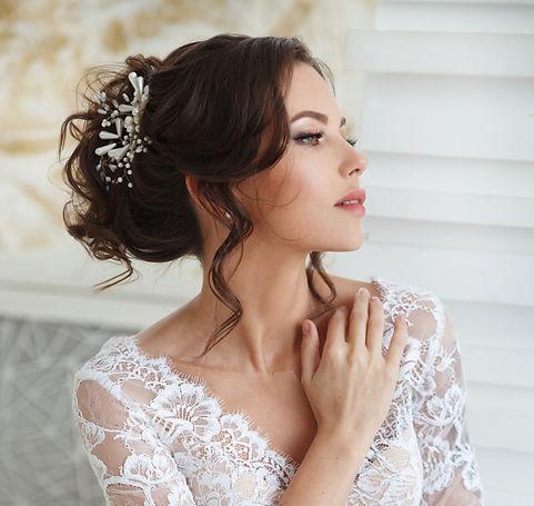 bride wearing bridal head piece