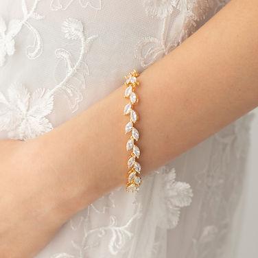 bride wrist with gold bridal bracelet marquise cut