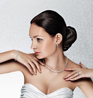 bride showing silver bridal bracelet on wrist