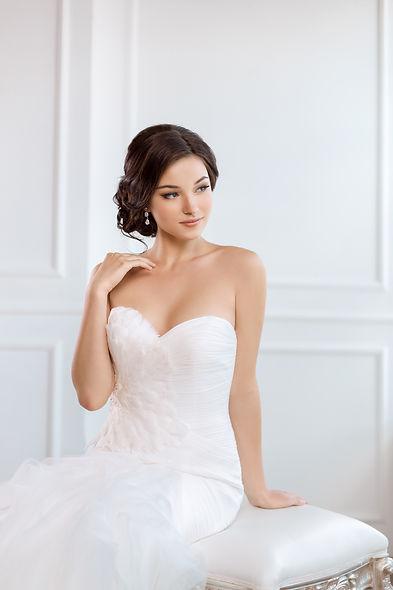elegant bride wearing drop wedding earrings