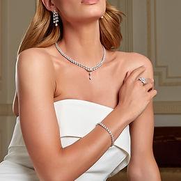 bride wearing wedding jewellery set earrings necklace and bracelet