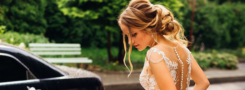 blonde bride with updo wearing clip-on bridal earrings