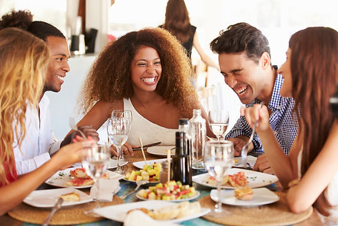 Group Of Young Friends Enjoying Meal In