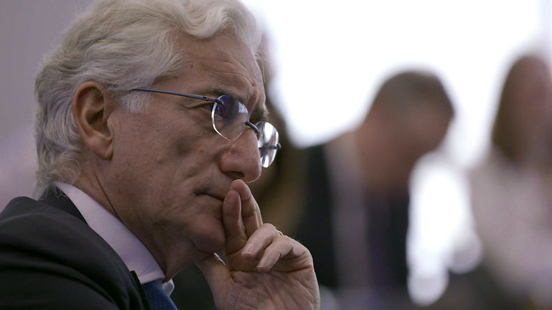 Close up of Sir Ronald Cohen, a busiessman, looking contemplative.