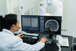 Doctor look analysing brain scan