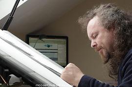 Wildlife Artist David Dancey-Wood at his desk-drawing