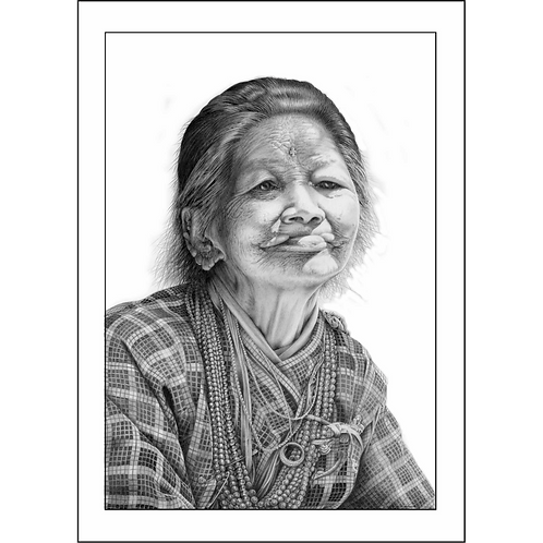 Tribal head and shoulders portrait of a older Tamang lady smiling