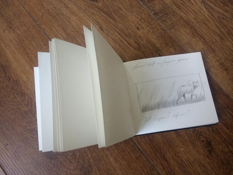 An open artist's sketch book