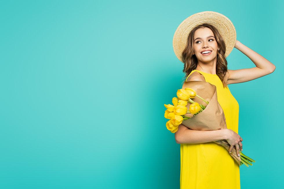 crello-474512154-stock-photo-positive-woman-sun-hat-holding.jpeg