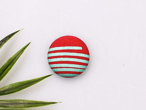 Red magnetic buttons with turquoise stripes
