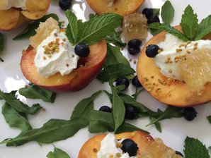 Grilled Peaches with Goat Cheese, Blueberries, Honeycomb and Bee Pollen