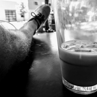Coffee emptying, feet up