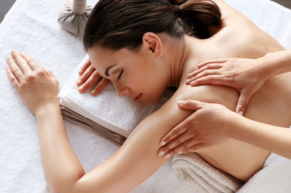 Massage with a reclining woman