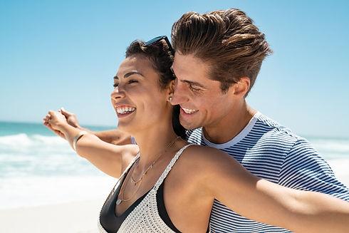 loving-couple-at-beach-enjoy-the-summer-