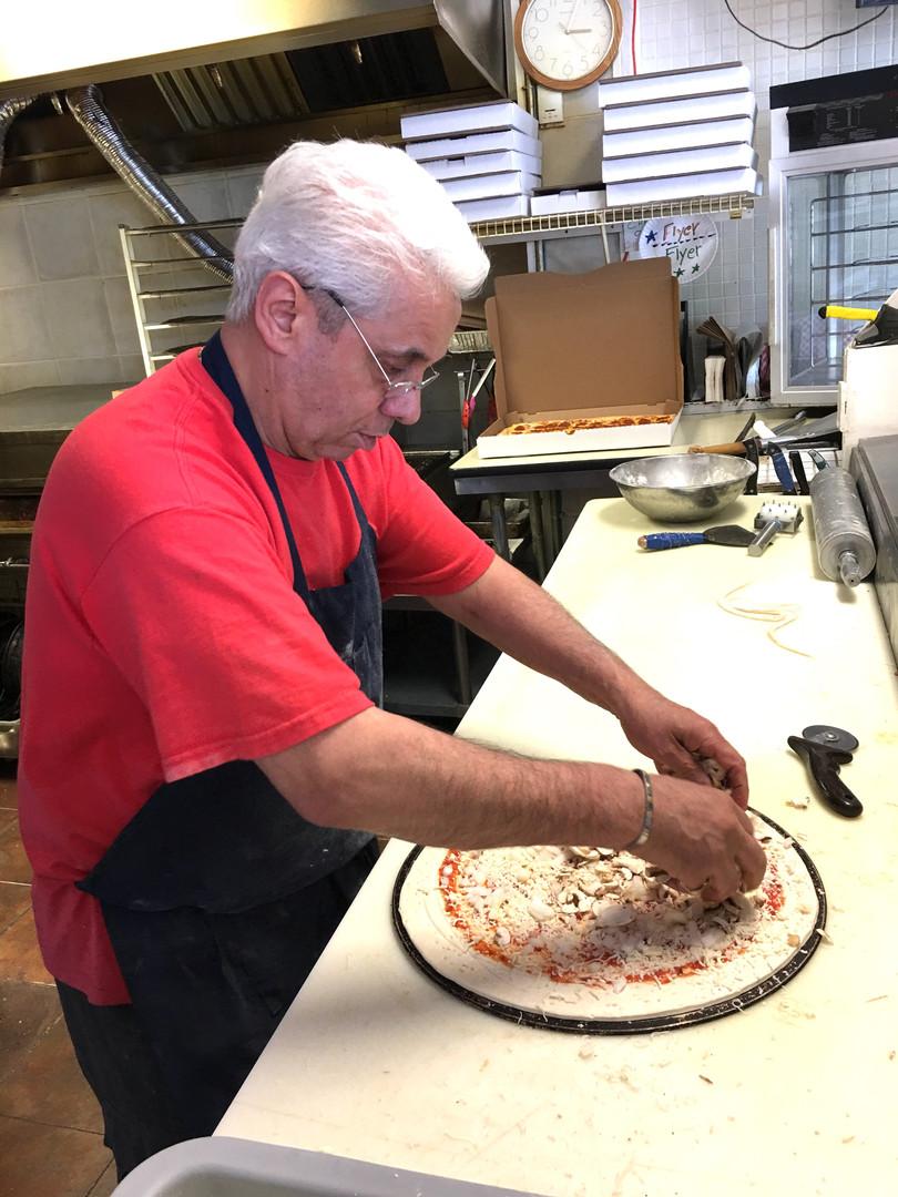 Eddie preparing pizza