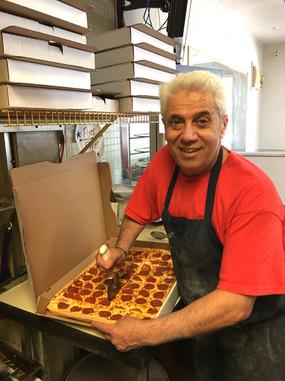 Eddie cutting Pizza