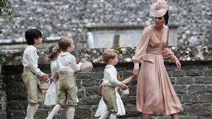 Princess Kate minding kids at wedding