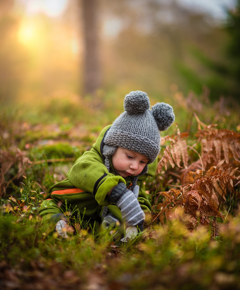 Toddler playing in nature