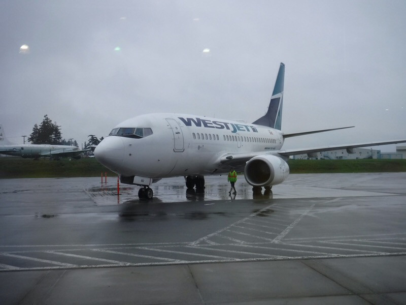 Picture of Westjet plane on runway at YQQ