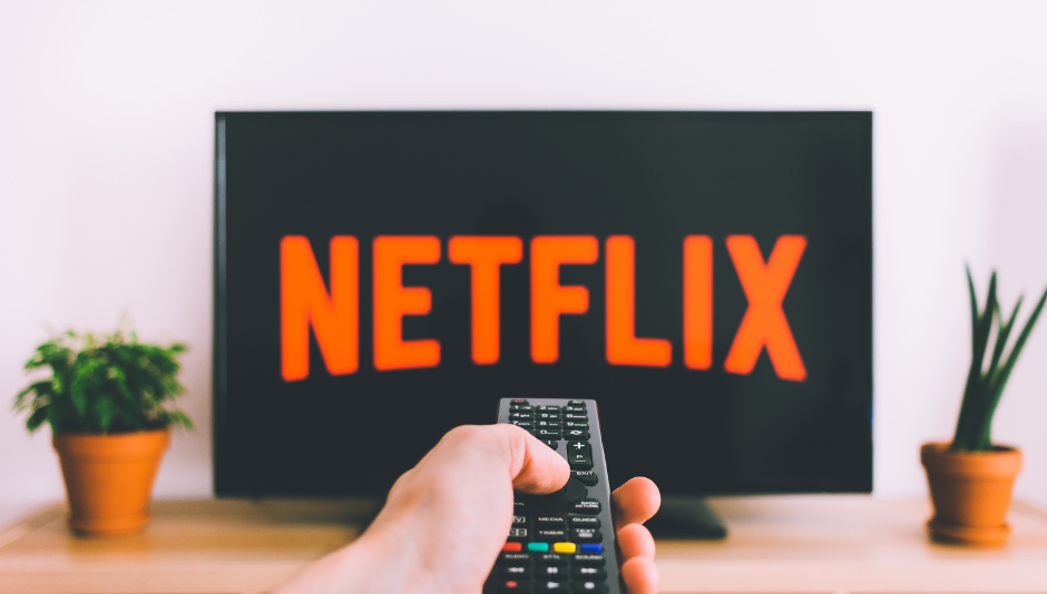 remote control pointing at Netflix screen