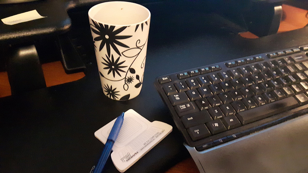 Picture of computer keyboard and RW Networks Inc. post it notes