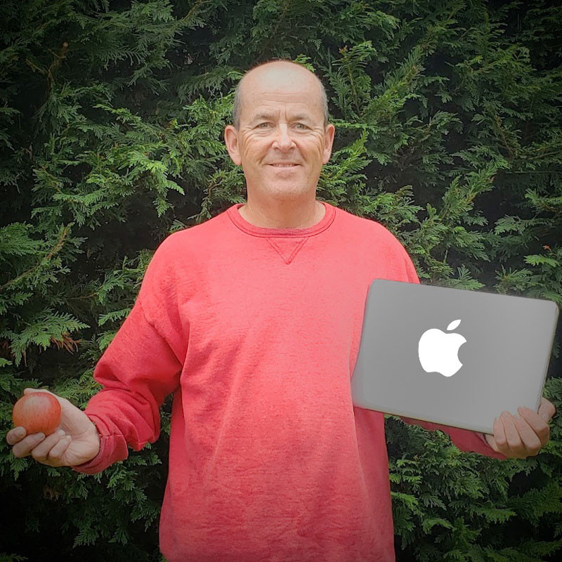 Rob Weiss, President of RW Networks Inc. holding an Apple laptop