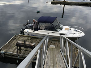 Ryan on the boat at the Ryan Walter Breakaway Retreat Centre