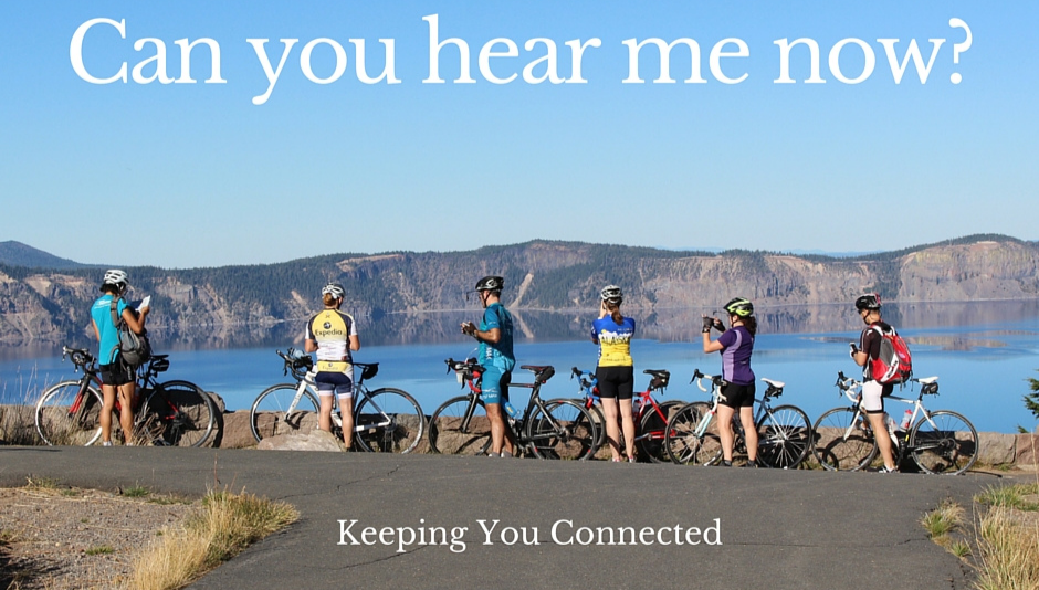 cyclists at Crater Lake Oregon on smartphones