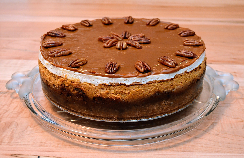 Caramel Pecan Pie Pumpkin Cheesecake with Sweetened Sour Cream