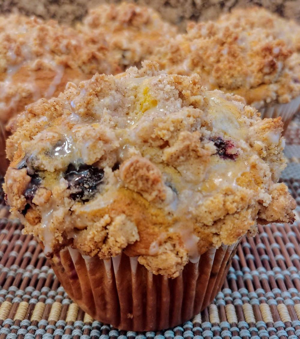 Spiced Blueberry Peach Yogurt Muffins with Sweet Vanilla Glaze