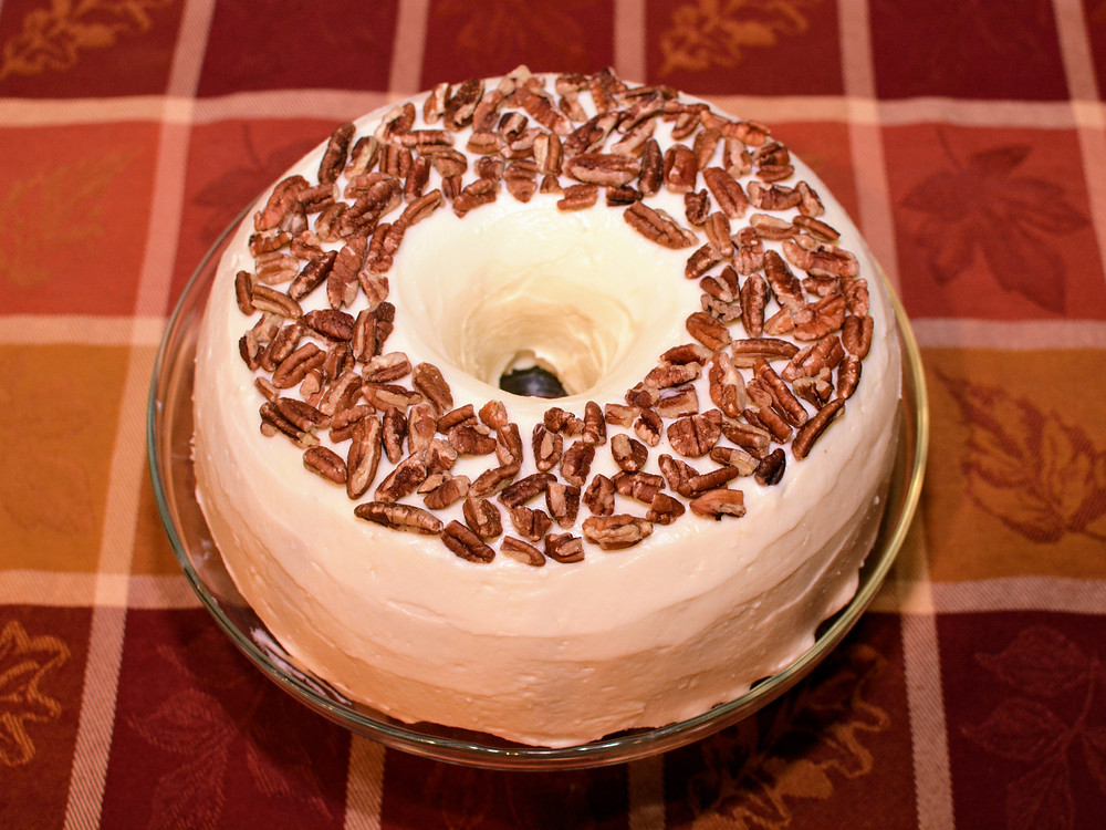 Carrot Cake Surprise Bundt Cake with Cream Cheese Frosting and Pecans