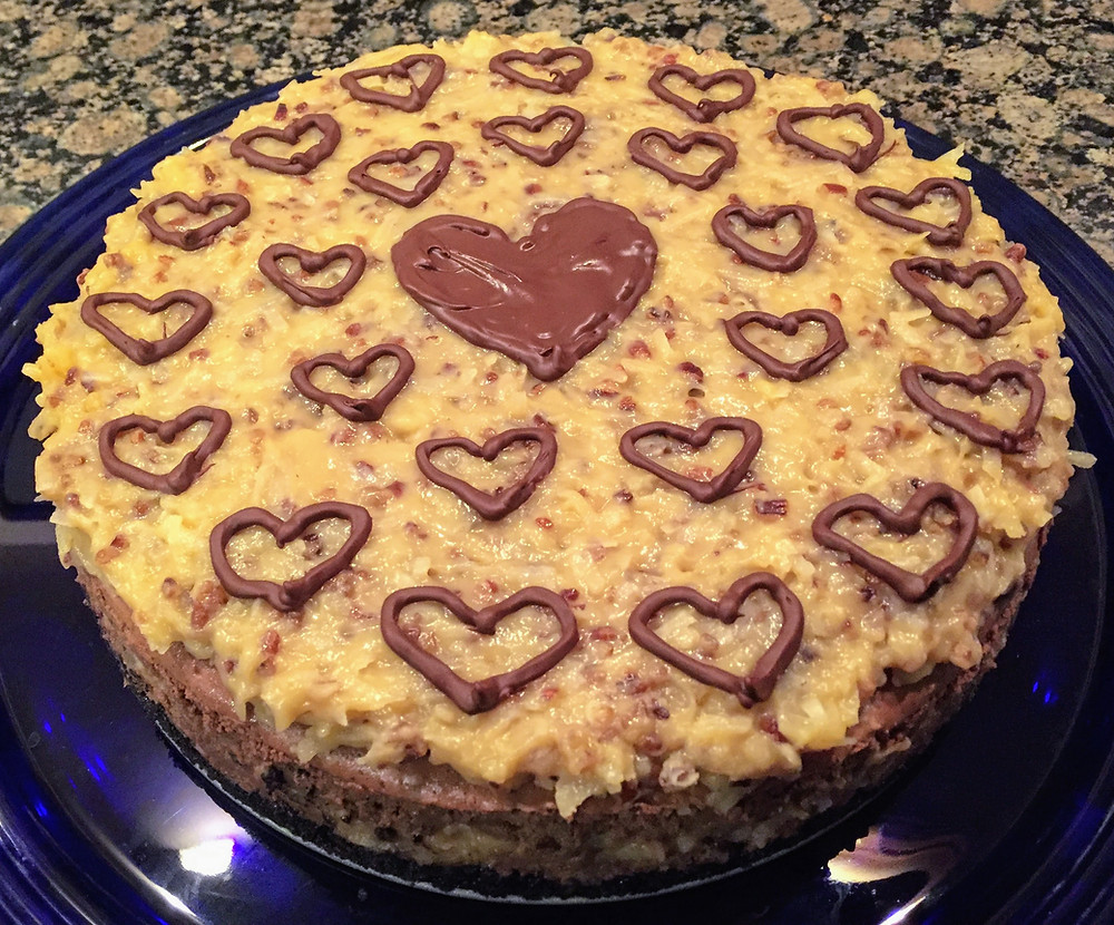 German Chocolate Cheesecake with Gooey Coconut, Pecan Topping