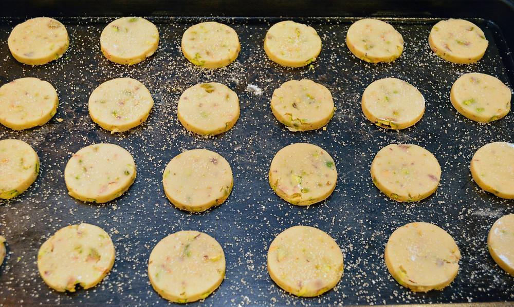 Dark Chocolate Pistachio Shortbread Cookies on baking sheet