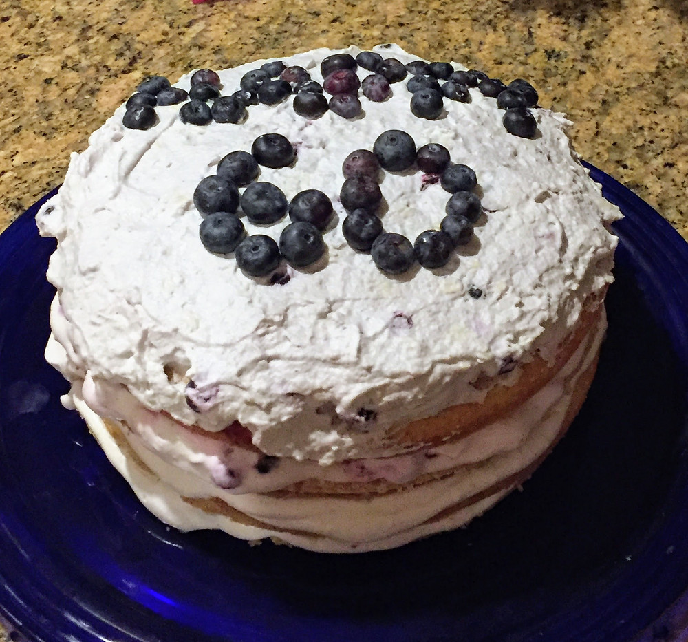 Light and Tender Blueberry Lemon Cake with White Chocolate Frosting