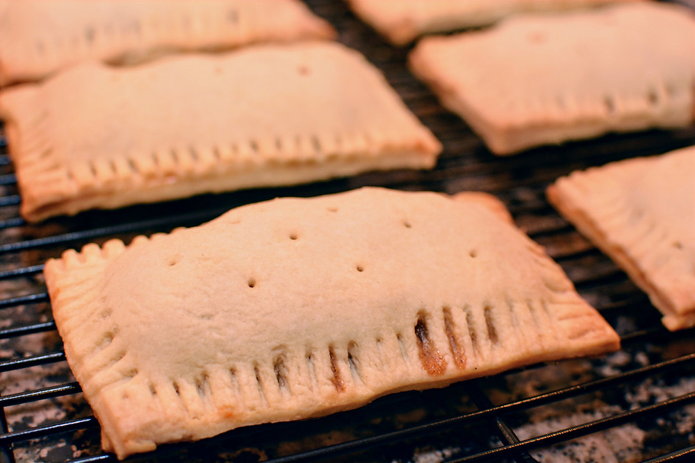 Apple Cinnamon Pop Tarts on cooling rack